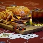 hamburger and coke on a casino table