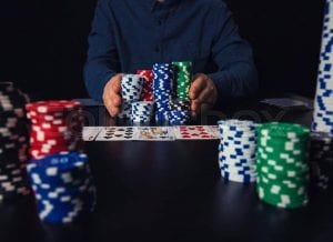 stashes of poker chips on a black table