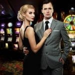 man and woman dressed semi-formally in a casino room