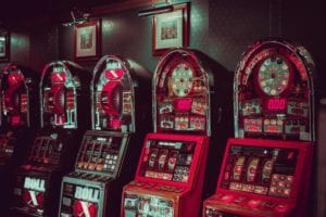 5 slot machines in pink and teal colors