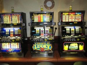 three slot machines standing next to eachother